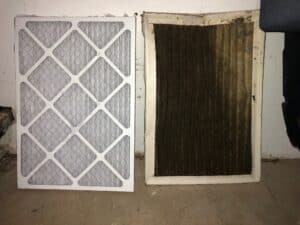 New air filter next to a dirty, old air filter